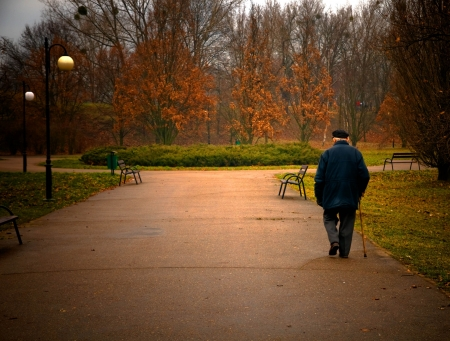 space age: Old age concept. Man walks in autumn park Stock Photo
