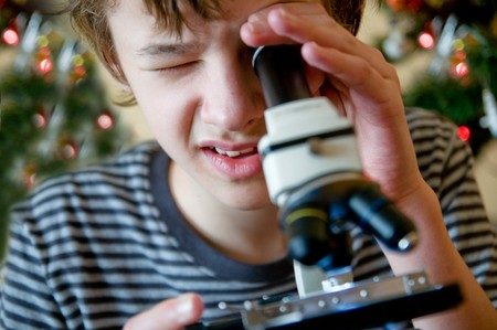 intrigued: Young boy intrigued by christmas present Stock Photo