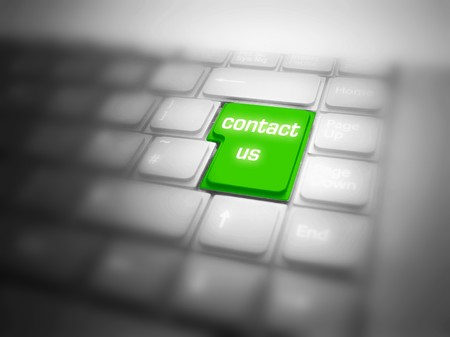 Green CONTACT US! button highlighted on keyboard. See also different versions! photo