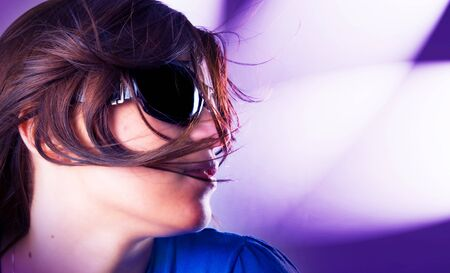 Portrait of a beautiful girl dancing on a party Stock Photo - 4406110
