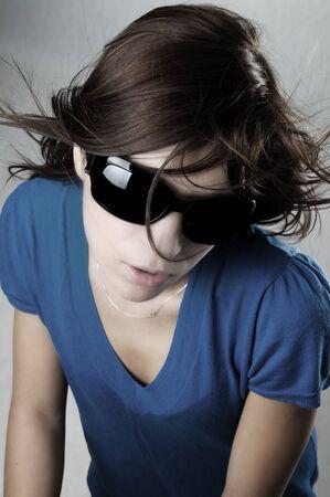 Modern, stylish portrait of a beautiful young woman photo