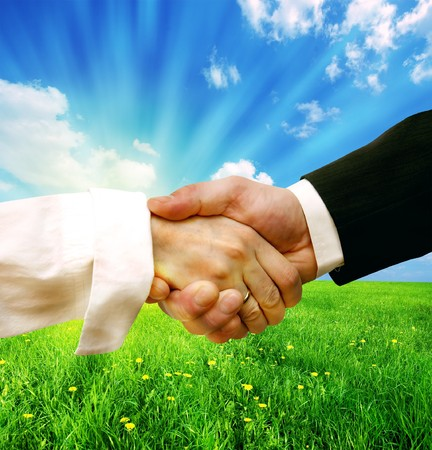 Business handshake on nature background concept photo