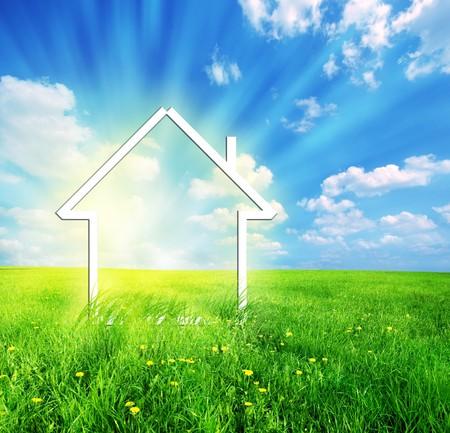 Nieuw huis verbeelding visie op de groene weide. Conceptueel beeld