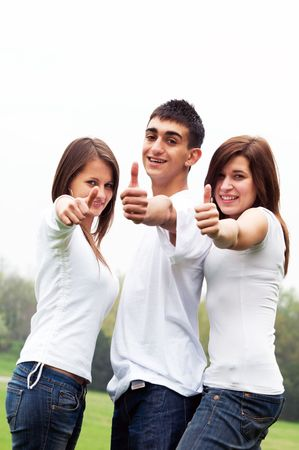 okey: Three young happy friends laughing and giving okey sing Stock Photo