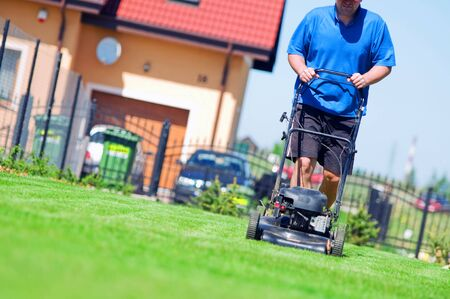 Man mowing the lawn. Gardening  photo