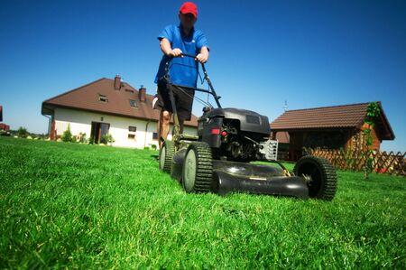 lawn mowing: Man mowing the lawn. Gardening