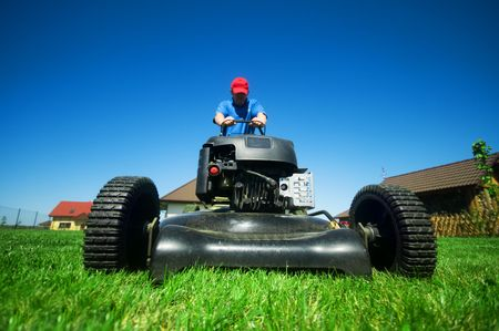 Man mowing the lawn. Gardening Stock Photo - 5340201
