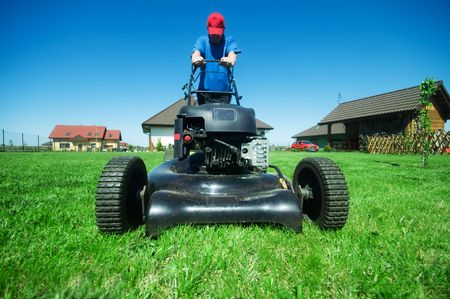 Man mowing the lawn. Gardening Stock Photo - 5340196