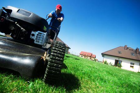 Man mowing the lawn. Gardening Stock Photo - 5340198