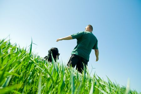 Man with a happy dog on the field Stock Photo - 5340193