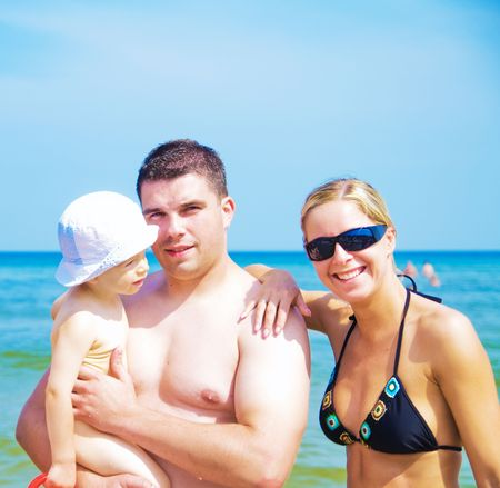 A happy family on the beach portrait photo