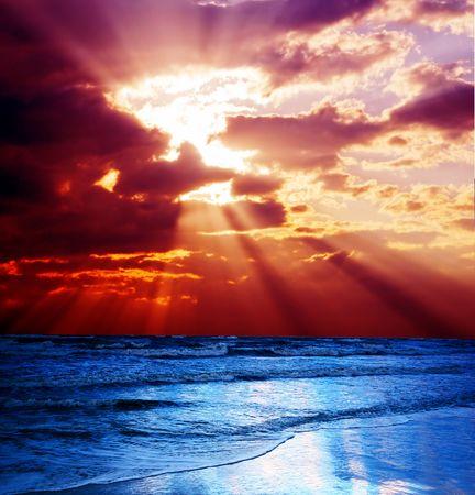 Surrealistic sunset seascape. Beautiful background photo