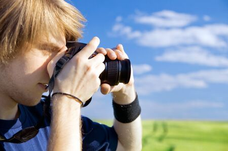 Photographer taking pictures outdoors photo