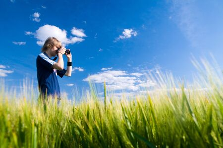 slr camera: Photographer taking pictures outdoors
