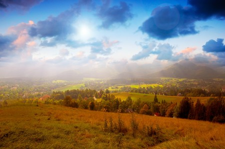 Rural summer landscape. Meadow and sunny sunset sky Stock Photo - 8105806