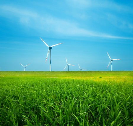turbin: Wind turbines on green field. Alternative source of energy