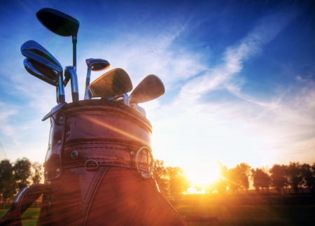 Professional golf gear on the golf field at sunset. photo