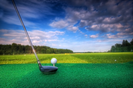 Playing golf. Golf club and ball. Preparing to shot photo
