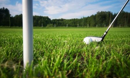 Playing golf. Golf club and ball. Preparing to shot Stock Photo - 8579899