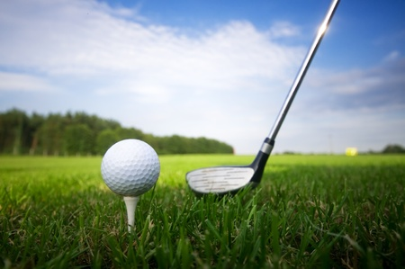 golf equipment: Playing golf. Golf club and ball. Preparing to shot
