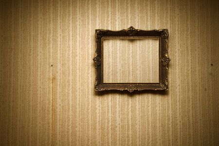 baroque picture frame: Old ornamented frame on retro grunge wall Stock Photo