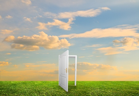 Open door to new life on the field. Hope, success, new life and world concepts. photo