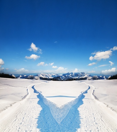 Two ways choice. Snowy winter landscape and mountains photo