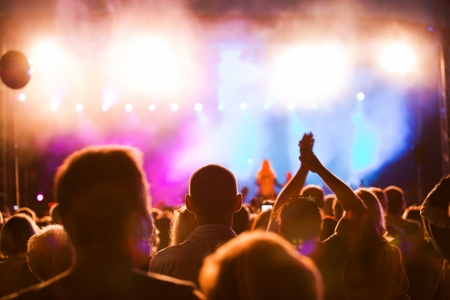 light show: Crowds of people having fun on a music concert Stock Photo