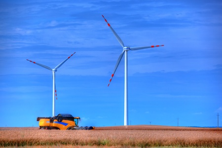Modern agriculture. Wind turbines on the field photo