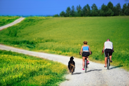 outdoor sports: Mature couple on bike. Sport, active lifestyle Stock Photo