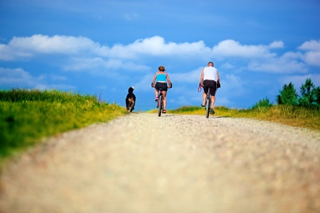 Mature couple on bike. Sport, active lifestyle photo