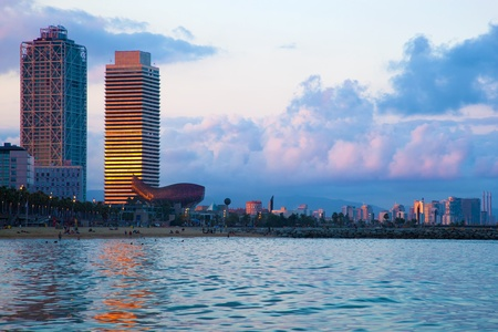 Barcelona skyline from sea. Barceloneta beach 스톡 콘텐츠
