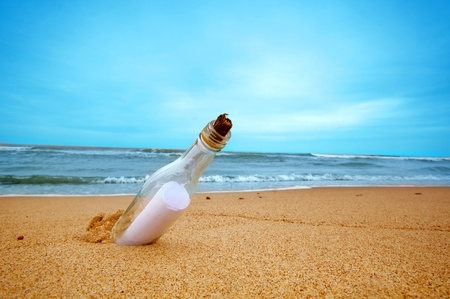 Message in the bottle from ocean. Travel, tourism, coming message concepts photo