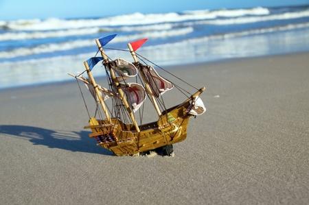 a battleship: Ship model on summer sunny beach. Travel, voyage, vacation concepts Stock Photo