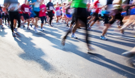 speed race: Running fast in marathon, legs close up. Sport, competition, energy. Stock Photo