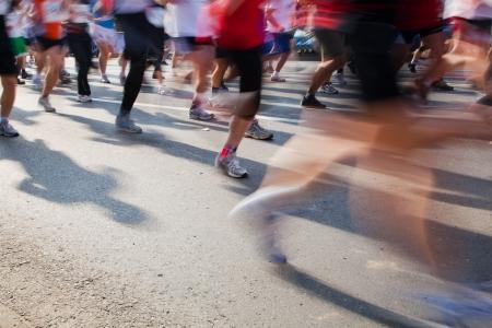 marathon running: Running fast in marathon, legs close up. Sport, competition, energy. Stock Photo