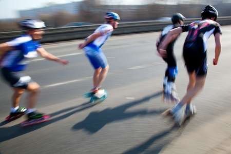 Roller blades skating race, competition. Fast motion Stock Photo