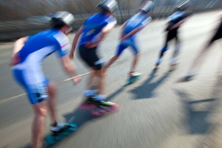 speed skating: Roller blades skating race, competition. Fast motion Stock Photo