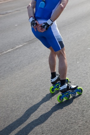 inline skater: Roller blades skating race, competition. Legs close up
