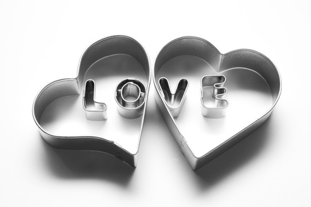 Love message in two hearts. Made of chrome metallic letters on white background photo