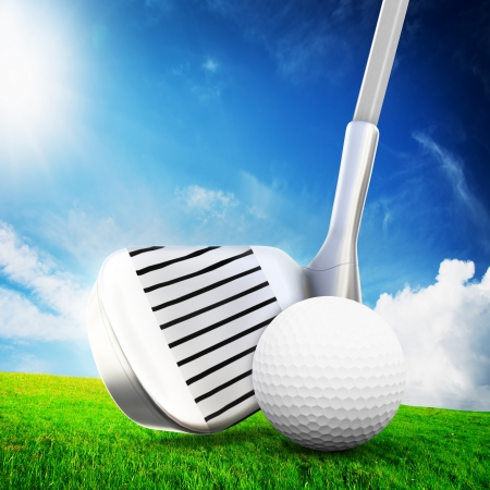 Playing golf  Ball, a golf club ready to shot  Sunny summer scene photo