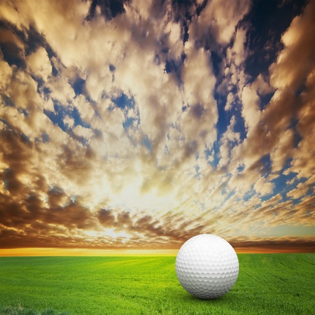 Playing golf  Ball on green golf field at sunset Stock Photo - 13150483