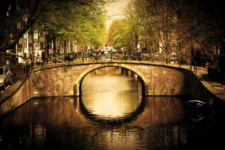 canals: Amsterdam, Holland, Netherlands. Romantic bridge over canal. Old town