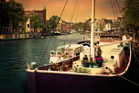 cruiser bike: Amsterdam, Holland, Netherlands. Romantic canal, boats. Old town Stock Photo