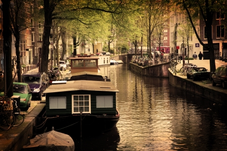 amsterdam canal: Amsterdam, Holland, Netherlands. Romantic canal, boats. Old town Stock Photo