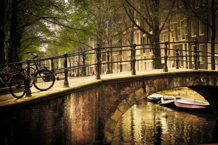 Amsterdam, Holland, Netherlands. Romantic bridge over canal. Old town photo