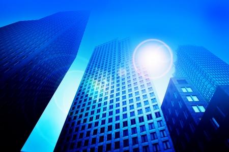 процветание: Бизнес небоскреба здания в синих тонах. Работа в офисе, большой город, финансы понятий Фото со стока
