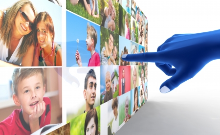Social media network. Blue hand pointing at screen full of people, faces photo