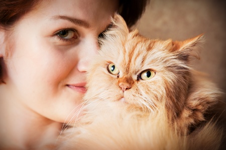 Young woman with Persian cat smiling portrait photo