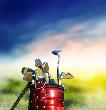 play golf: Golf clubs on grassy golf course. Sport, recreation